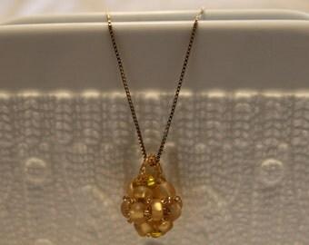 Beautiful golden beaded Pendant; beadweaving, handmade, cute, elegant