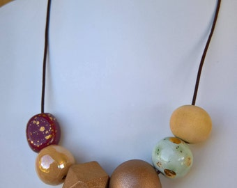 Large Geometric Necklace with Kazuri and Wooden Beads in Copper Gold Tones