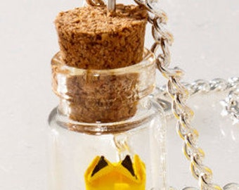 Pendant origami Pikachu in tiny glass bottle
