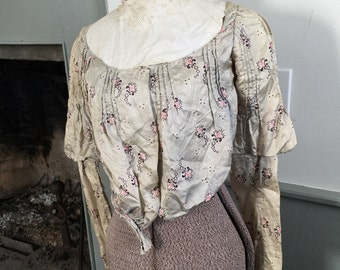 Unusual vintage Victorian silk blouse in a pale blue with pink accents