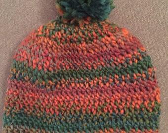Red/green/orange pom pom beanie