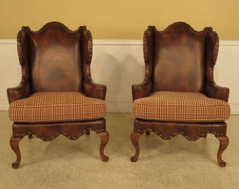 28971E: Pair CENTURY Upholstered Wing Back Leather Chairs
