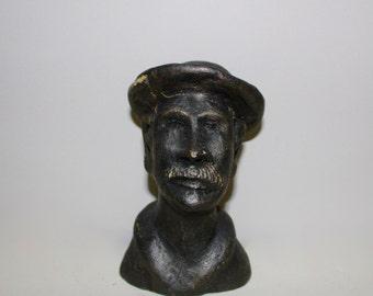 Cast sculpture of an old man