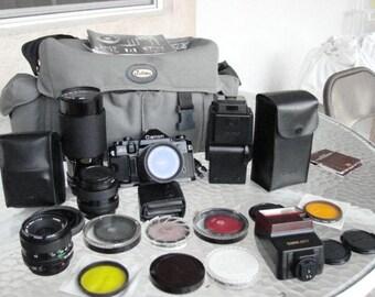 canon a1 camera 4/canon lens,1.4,28mm,70-210,35-70 lens