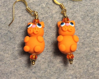 Orange polymer clay cat bead earrings adorned with orange Chinese crystal beads.