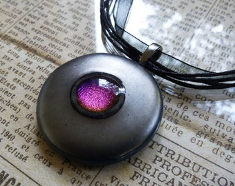 Dichroic glass pendant, with pink/purple dichroic detail surrounded by metallic pewter coloured glass.