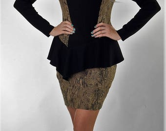 Custom peplum dress with accent back zipper with rushed sleeve detail.