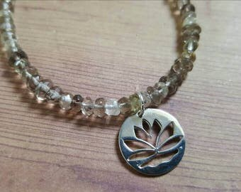 Smokey Quartz Bracelet in Sterling Silver with a Lotus Charm