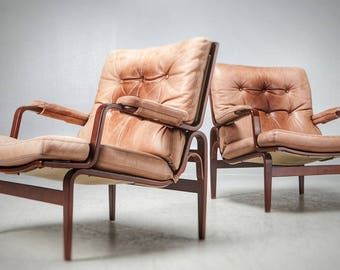 A pair of Bruno Mathsson Ingrid chairs in leather and rosewood stained frame circa 1970's
