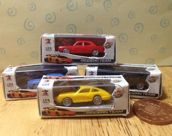 Dolls house miniature replica remote control car with remote and box  for your dolls house nursery 1/12 scale