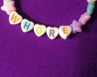 Cute pastel goth babygirl word letter bracelet with love hearts, stars