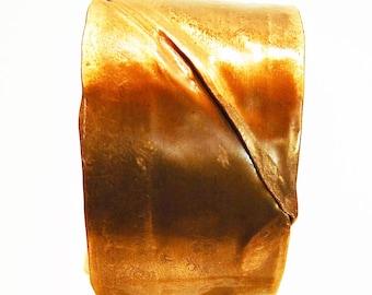 Copper cuff form folded hemmed bracelet.
