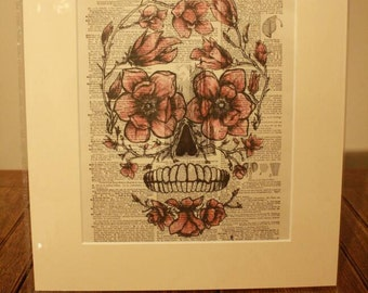 """Ideal gift, Dictionary art print rose sugar skull printed on 1907 dictionary sheet in a 12"""" x 14"""" cream mount."""