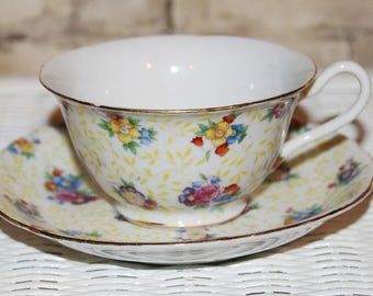 Vintage Noritake Chintz Teacup and Saucer in Porcelain Pale Yellow with Random Flowers In Pink and Yellows c1940's