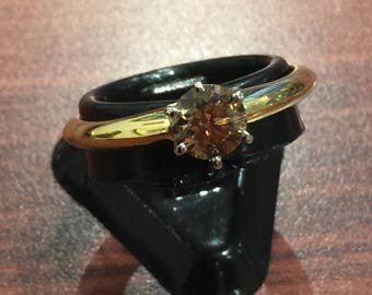 An Argyle Cognac Diamond Solitaire Ring in 18K Yellow Gold