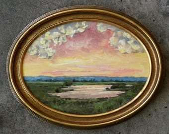 """9 X 12"""" Oval landscape oil painting with pond set off beautifully in a gold frame."""