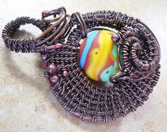 Oxidized copper woven wire & etched multicolored lampwork bead pendant