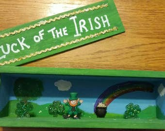 "St. Patrick's Day slide top shadow box - ""Luck of the Irish"" with leprechaun, pot of gold, and glittery shamrock with a hand painted scene"