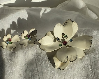 White enamel dogwood flower brooch and matching clip earrings