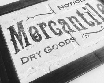 Vintage Mercatile Sign on Faux Brick Wall