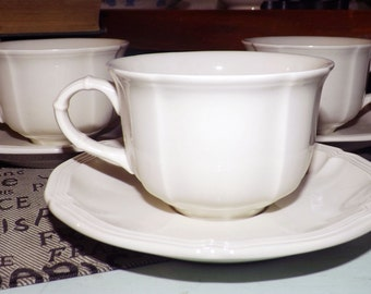 SET of 3 vintage (c. early 1980s) Villeroy & Boch Manoir tea sets (flat cups w/matching saucers). Classic antique white, embossed details.