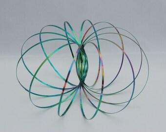 Flow Rings Kenetic Spring Toy Arm Slinky Toroflux COLORS!