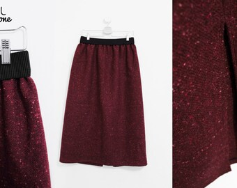 Long skirt in pure cherry-coloured wool with elastic waist in black rib and slit on the back
