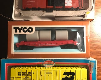 Three model train cars