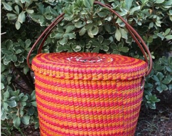 Colorful handwoven basket made of palm grass.