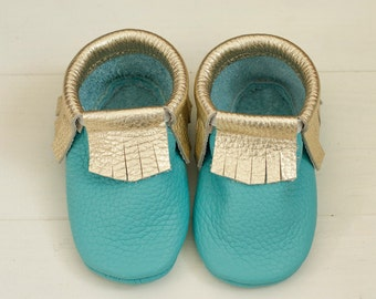 Turquoise baby moccasins with golden fringe  Soft shoes Newborn first shoes
