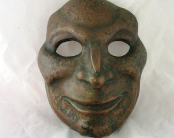 Antique copper Venatian mask. An amazing grotesque copper mask. Old Italian carnival copper mask