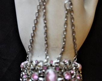 Silver metal slave bracelet with pink beads