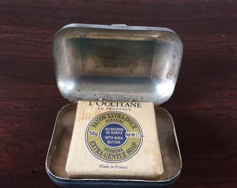 Vintage soap tin, metal tin for travel.  Shiny aluminum tin with tight patented closure.  Comes with soap as shown.