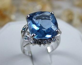 Dazzling intense Swiss Blue Topaz Main Stone 12..5mm x 13.7mm. SAPP 925 Silver Ring.  Size 7