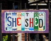SHE SHED custom license plate signs