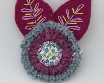 Felt and crochet flower brooch with embroidery detail