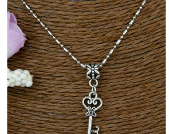 Vintage Skeleton Key,  Charm Flower Necklace, Silvertone***I will be on vacation from 6/10-6/20. Items will be shipped out on 6/21***