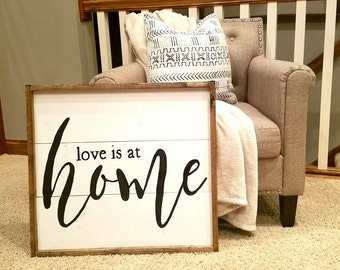 Love is at home sign