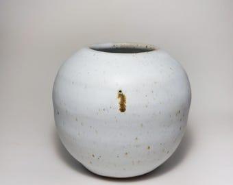 White stoneware moonjar round vase with brown metallic iron spots