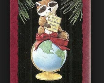 Out of this world teacher 1994 Hallmark Keepsake Ornament - Raccoon sitting on the World.