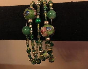 Memory wire bracelet in shades of green.
