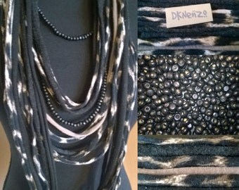 Tshirt Scarf in the colours: black and beige/taupe tones and 1 loose long black beads necklace