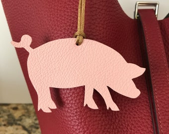 Leather pig bag charm on cord