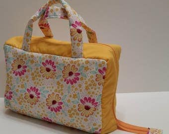 Gold and Fuchsia Flower Lunch Tote Opening Into a Tray.