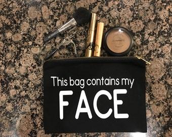 This BagContains my Face black canvas makeup bag