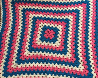 Hand crochet pink/blue and white baby blanket.