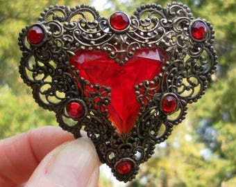 Heart brooch French vintage. Finely sculpted metal and bright red glass.