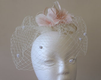 White veiling with light pink feathers and sinamay curls