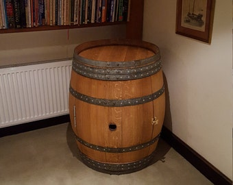 Drinks cabinet made from a used wine barrel