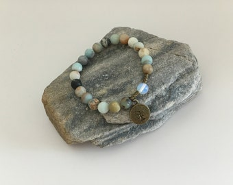 Soothe troubled nerves fertility childbirth hormones pregnancy endings beginnings moonstone amazonite stress relief protection travelers